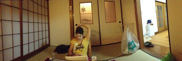 here I am sitting in the downstairs tatami mat room, just off the kitchen. Doing something odd, as usual.